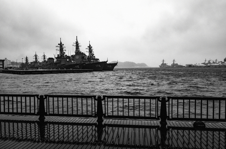 stormy waters: YOKOSUKA, JAPAN - APRIL 11, 2017 - Arleigh Burke-class destroyers anchored in stormy waters at the United States Fleet Activities Yokosuka Navy base