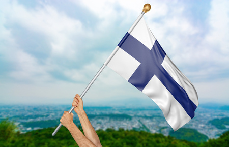 Young mans hands proudly waving the Finland national flag in the sky, part 3D rendering Stock Photo