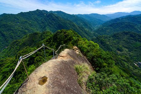 Dangerous hiking trail along a narrow and rocky mountain ridge at Wu Liao Jian in Taiwan