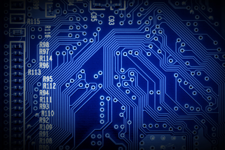 Modern microchip technology background of a printed circuit board, or PCB