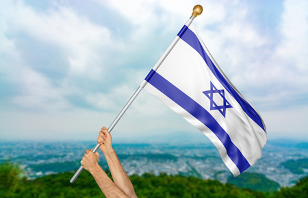 Young mans hands proudly waving the Israel national flag in the sky, part 3D rendering