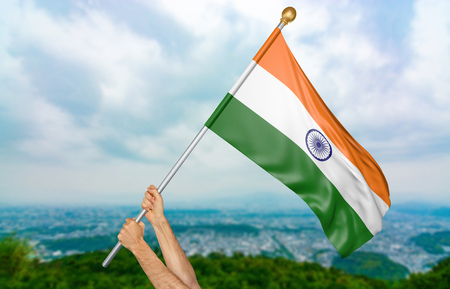 Young mans hands proudly waving the India national flag in the sky, part 3D rendering