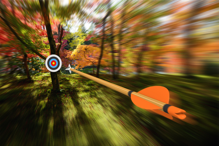 Arrow moving with precision and blurred motion toward an archery target, part photo, part 3D rendering Stock Photo