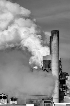 Harmful CO2 emissions from a paper factory contributing to carbon pollution Stock Photo
