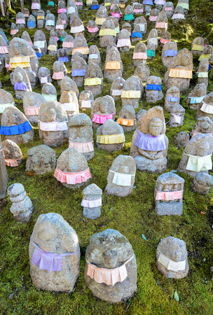 provide: Japanese Jizo statues to remember deceased children. The aprons provide cloth for Jizos robe to protect the children in the afterlife.