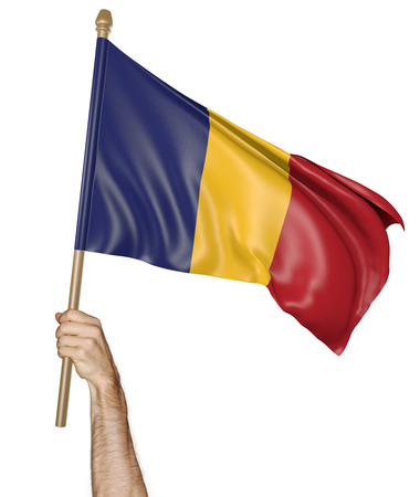 Hand proudly waving the national flag of Chad isolated on a white background, 3D rendering