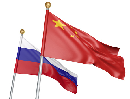 Isolated China and Russia flags flying together for diplomatic talks and trade relations, 3D rendering Stock Photo