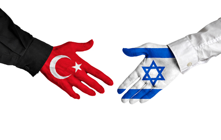 Turkey and Israel diplomats shaking hands for political relations