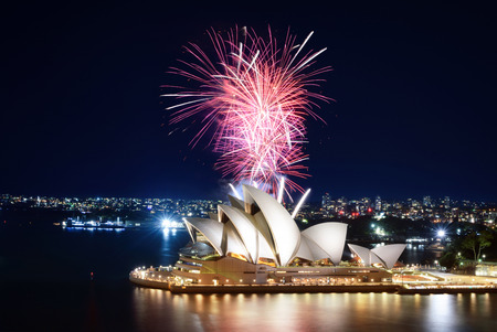 SYDNEY, AUSTRALIA - MARCH 8, 2018 - A huge burst of pink fireworks light up the harbor around the Sydney Opera House Editorial