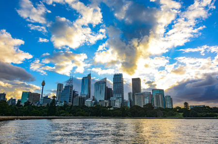 Amazing sunset over the Sydney central business district city skyline seen across the harbor from the Botanic Gardens Stock Photo