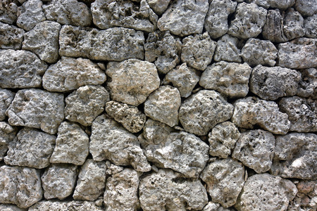 Background texture from a natural rock wall of fitted stones built without mortar 写真素材