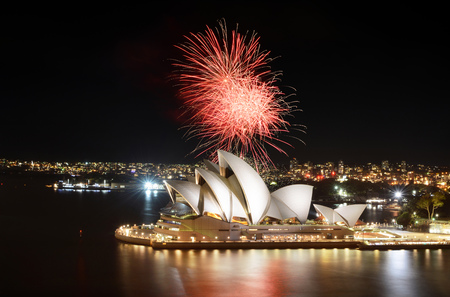 SYDNEY, AUSTRALIA - MARCH 8, 2018 - Fiery red fireworks light up the Sydney Opera House and Harbor in a brilliant display Editorial