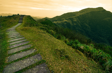 Stepping stone footpath leading over a hill into a storybook landscape on the Taoyuan Valley Trail in Taiwan