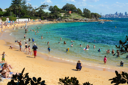 SYDNEY, AUSTRALIA - MARCH 18, 2018 - Australian beachgoers escape the heat in the cool waters of Camp Cove Beach at Watsons Bay in Sydney