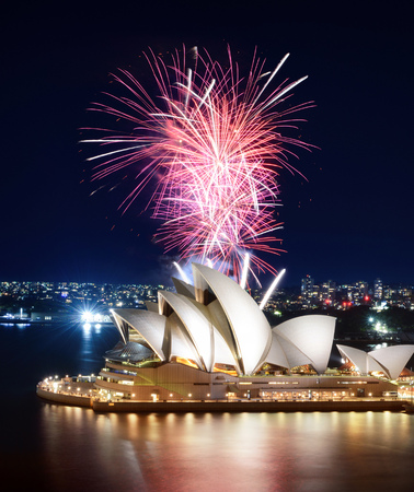 SYDNEY, AUSTRALIA - MARCH 8, 2018 - Incredible volley of pink fireworks erupting above the Sydney Opera House