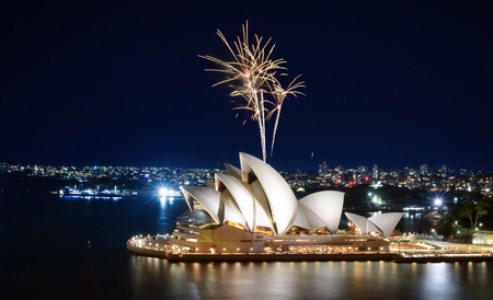 SYDNEY, AUSTRALIA - MARCH 8, 2018 - Blast of gold sprinkler-like fireworks at the Sydney Opera House Sajtókép