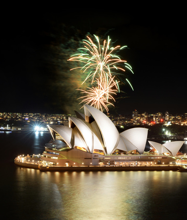 SYDNEY, AUSTRALIA - MARCH 8, 2018 - Huge bursts of golden fireworks light up the Sydney Opera House and harbor