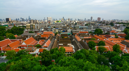 Wide cityscape view of Bangkok City in Thailand with historic and modern buildings