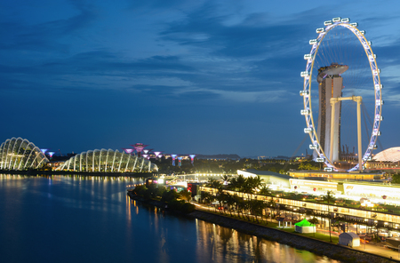 Singapore - September 9, 2018: Singapore Flyer and Marina Bay landscape at night Sajtókép