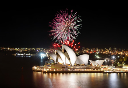 Colorful bursts of fireworks fill the night sky at the Sydney Opera House