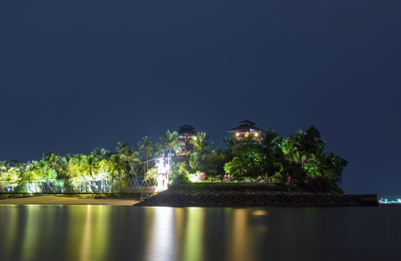 Night reflections at Palawan Island in Sentosa, Singapore