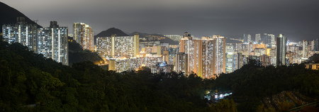 Skyline of the densely populated Chai Wan district in Hong Kong illuminated by city lights at night