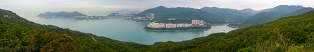 Super wide panorama of Tai Tam Bay and Red Hill in Hong Kong, as seen from Dragons Back hiking trail