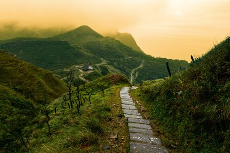 Storybook-like pathway through a misty mountain landscape in Taiwan's Yilan County
