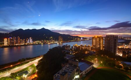 Romantic sunset and colorful city lights along the Tamsui River in New Taipei City, Taiwan