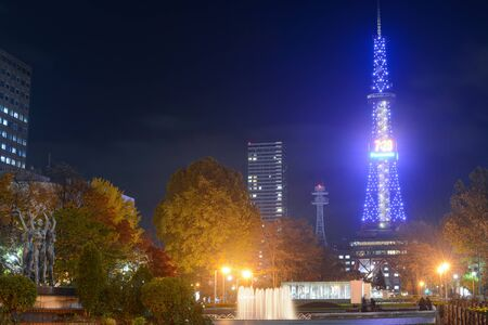 Sapporo TV Tower shines like a blue beacon in Odori Park on a chilly autumn night