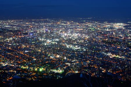 Dazzling night view of Sapporo, Japan with the city center glowing brightly