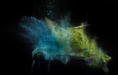 busting: Color powder exploded, isolated on control environment. Stock Photo