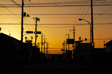 Silhouette electric pole and cable over the dramatic sunset, Japan.