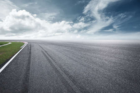 Dramatic view of racing asphalt road.