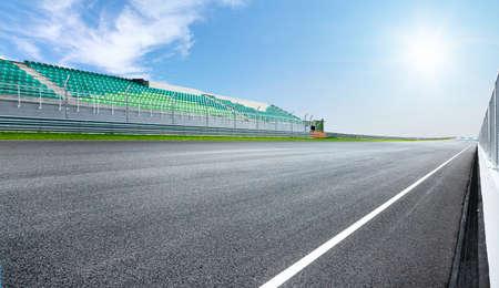 Dramatic view of racing asphalt road and grand prix seat.