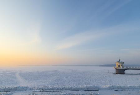 Sunrise lake in winter photo