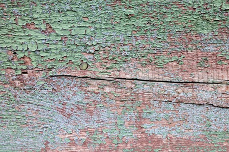Cracked paint on a wooden wall.  photo