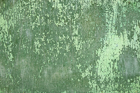 flaking: Flaking Green Paint on Faded Wood Background. Peeling paint Stock Photo