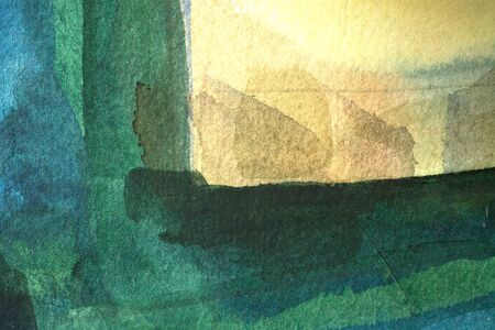 green watercolor background - paints on a rough texture paper