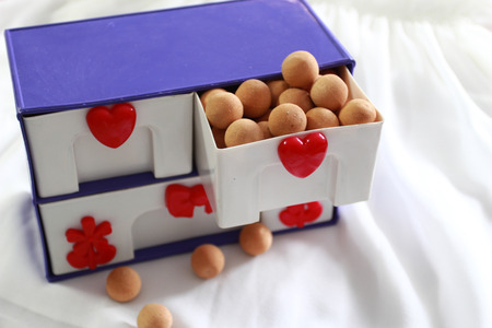 Thewooden balls in the plastic cabinet