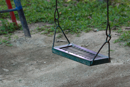 swaying: the swing in the playground  Stock Photo