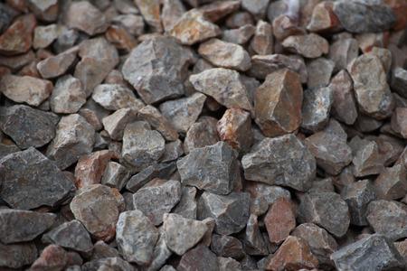 De gemalen steen op de grond
