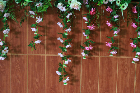 loosely: The wall decoration by flower droopy But they made frome plastic