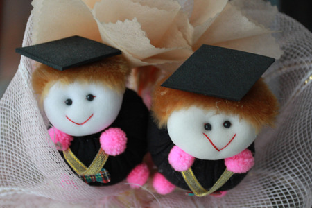 congreatulation dolls arrange with fabric.It is the gift for person who graduated. Stock Photo