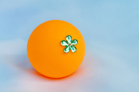 decorate: The orange ball decorate by plastic flower.Invent it be a toy for children.