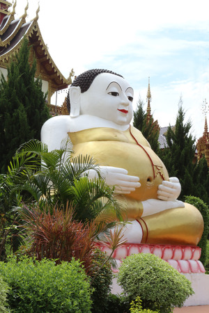 The statue of happy Buddha is located at temple. 版權商用圖片