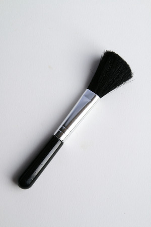 The black brush have metal handle.Use for cleaning cleaning appliance.