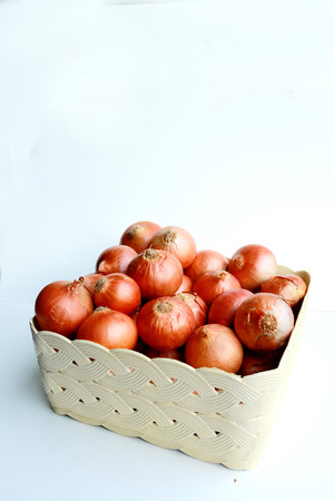 ingrediant: Many onions in the basket.They are good for helth. Stock Photo