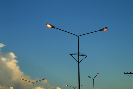 automatically: The streetlamp turn on the light automatically when dark.