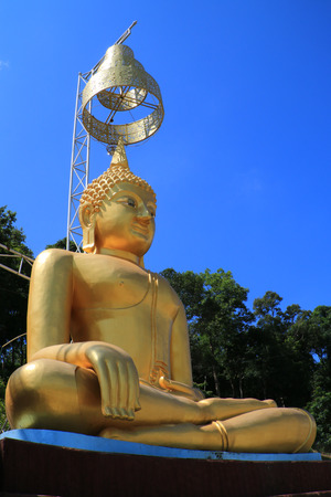 buddha image: The golden image of Buddha which have Thai art umbrella over the head. Stock Photo